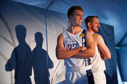 IndyCar drivers Oliver Askew, left, and Charlie Kimball strike a pose for photos, after the unveiling of the 2019-20 Indiana Pacers CITY EDITION Jersey, at the Indianapolis Motor Speedway, Thursday, Nov. 21, 2019.  They modeled the new jerseys during the unveiling.
