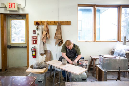 Ceramics teacher Adam Hanson uses a wheel to spin a clay mug, Wednesday, Nov. 20, 2019, at Scattergood Friends School in West Branch, Iowa. Hanson is in his first year teaching at the school.