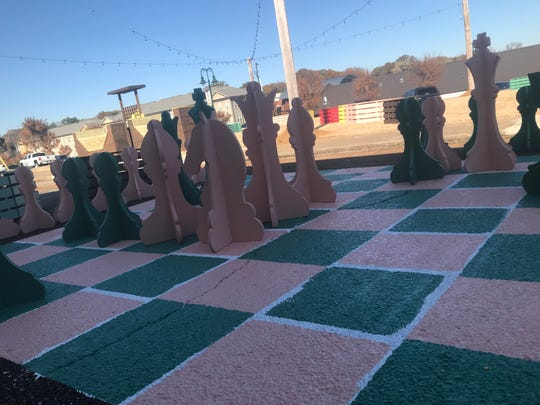 A giant chess board is one of the main attractions of the new pop-up park in Downtown Jackson.