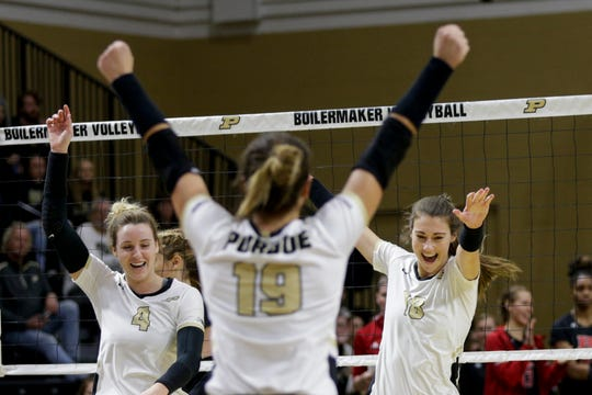 Purdue outside hitter Caitlyn Newton (4) and Purdue middle blocker Jael Johnson (18) celebrate a block during the first set of a NCAA women's volleyball game, Wednesday, Nov. 20, 2019 at Holloway Gymnasium in West Lafayette.