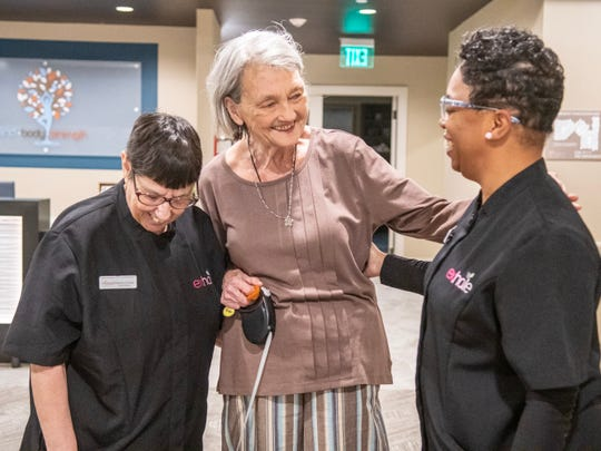 Avanti caregivers Patricia Crochet, left, and Wilnell Simoneaux, right, talk to Lynda Wooldridge. Avanti is a new senior care facility in Lafayette.