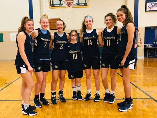 The Lancaster girls basketball team opens the season Saturday in Cleveland against Logan. This year's seniors are, from left to right: Madison Dean, Ally Thompson, Halle Spangler, student assistant, Maizie Rigsby, Savannah Dryden, Hallie Rose and Brittany Azbell.