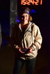 Brighton woman Loretta Tobolske-Horn poses with the medal she won by winning the Tunnel Hill 100-mile race on Nov. 9, 2019 in Vienna, Ill.