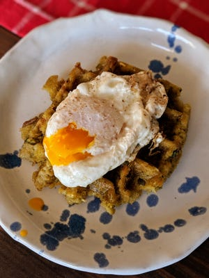 Courier Journal food columnist Dana McMahan suggest throwing your leftover Thanksgiving stuffing in a waffle maker, t hen topping it with an egg and some gravy for the perfect brunch dish.