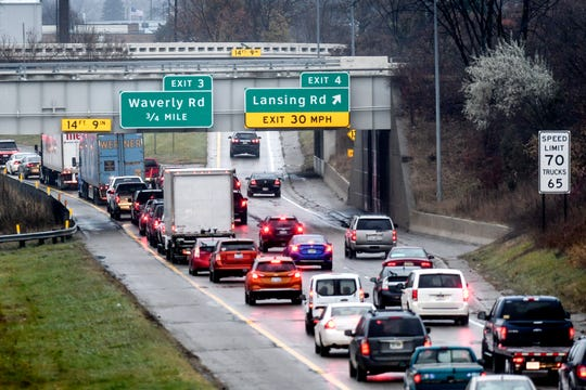 Traffic backs up on westbound on I-496 at the Lansing Road exit due to a minor crash near the Waverly Road exit on Wednesday, Nov. 21, 2019, in Lansing. Crews will reconstruct the section of freeway between Interstate 96 and Lansing Road next spring.