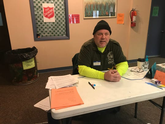 Greg Nickerson of Holt finishes a volunteer shift Nov. 15, 2019 at the Salvation Army's South Pennsylvania Avenue location. He had to provide community service as part of a traffic violation conviction but plans to stay on.