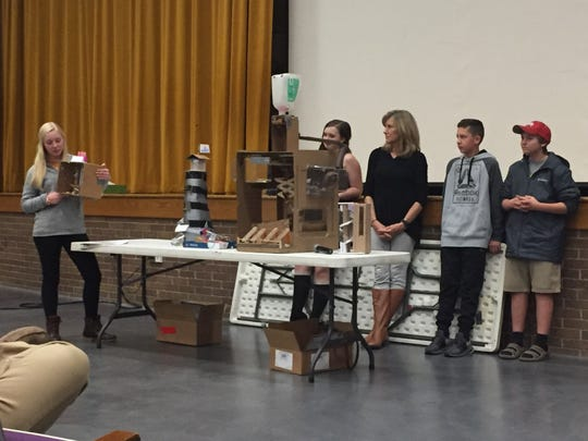 Lexington Junior HIgh students demonstrated how their gumball machines worked at Wednesday's school board meeting.