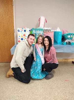 Todd Burkhart and Kyla Hayton are shown with their 4-year-old daughter Ariella in this photo.