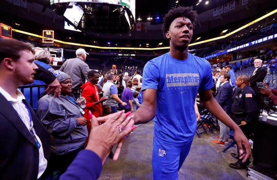 Memphis Tigers center James Wiseman high-fives fans after their 68-58 win over the Little Rock Trojans guard during their game at the FedExForum on Wednesday, November 20, 2019.