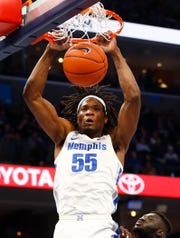 Memphis Tigers guard Precious Achiuwa dunks the ball against the Little Rock Trojans during their game at the FedExForum on Wednesday, November 20, 2019.