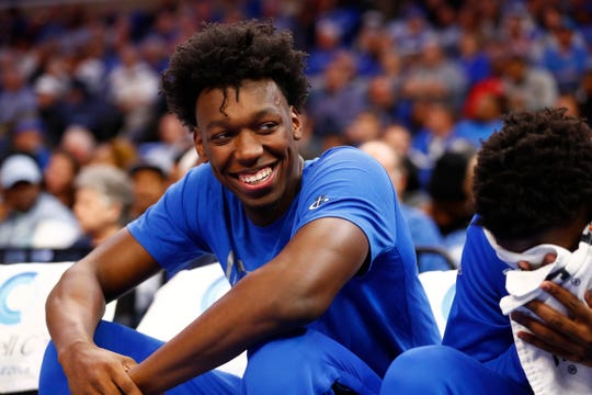 Memphis Tigers center James Wiseman jokes with his teammates on the bench during their game against the Little Rock Trojans at the FedExForum on Wednesday, November 20, 2019.