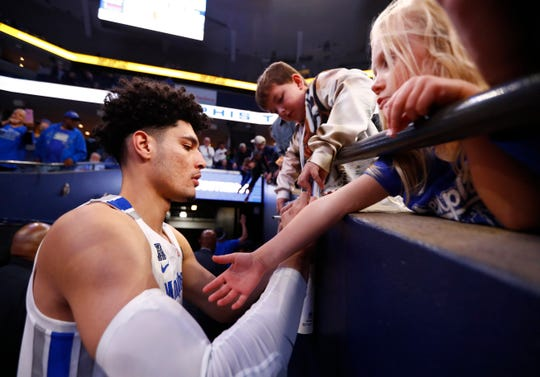 Memphis Tigers forward Isaiah Maurice signs autographs for young fans after their 68-58 win over the Little Rock Trojans at the FedExForum on Wednesday, November 20, 2019.