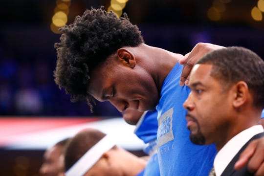 Memphis Tigers center James Wiseman bows his head for the National Anthem before they take on the Little Rock Trojans at the FedExForum on Wednesday, November 20, 2019.