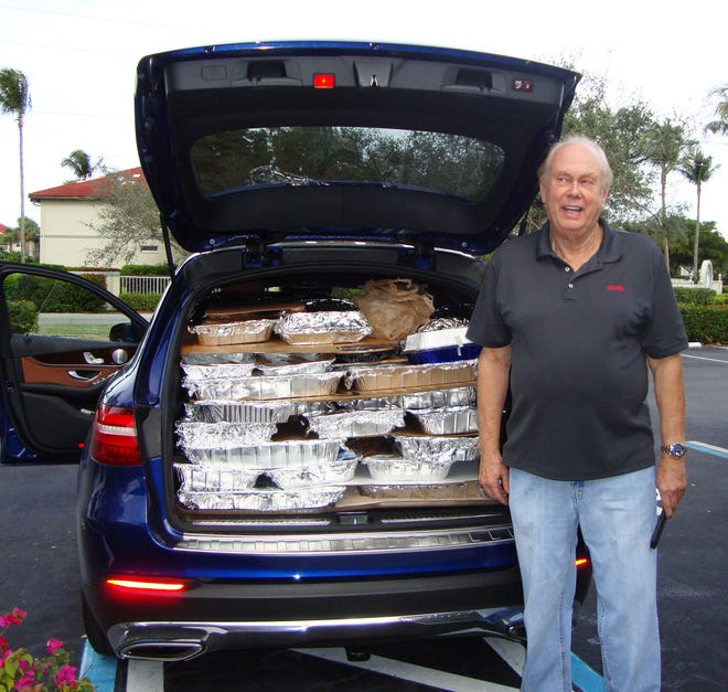 Bill Filbin with a delivery to St, Matthews house during a previous Thanksgiving.