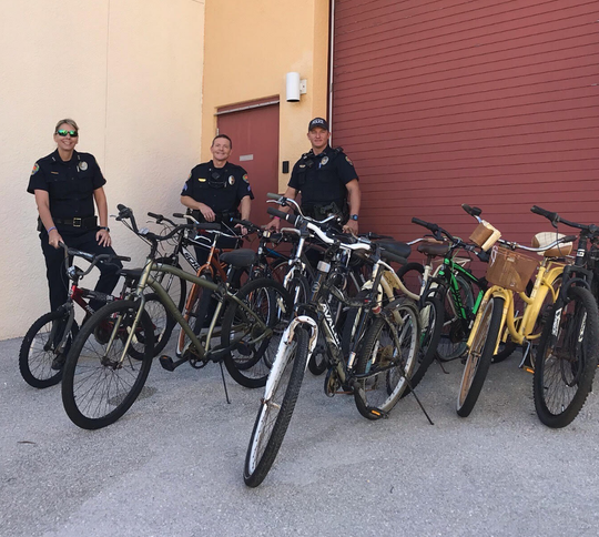 Marco Island Police Department donatedon Nov. 21, 2019 twelve abandoned bikes toBahamas as part ofpost-Hurricane Dorian relief effortsled by the Marco Patriots. From left to right, Chief Tracy L. Frazzano, Sgt. Brian Hood and officer Josh Ferris.