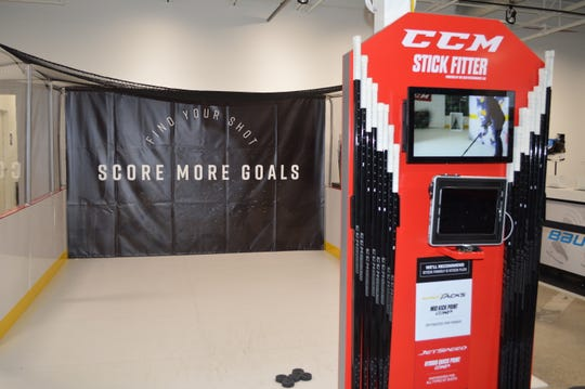 Hockey players can get stick recommendations, using the CCM Stick Fitter at Pure Hockey in Mequon.