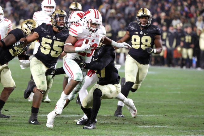 UW running back Jonathan Taylor ran through Purdue's defense for 331 yards and three touchdowns in the Badgers' three-overtime victory last season, with most of his yards coming after halftime.