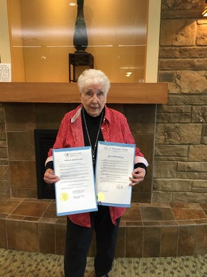 JoBelle Zimmerman (pictured above) is seen holding proclamations signed by Mountain Home Mayor Hillrey Adams and Baxter County Judge Mickey Pendergrass proclaiming November as National American Indian Heritage Month and urging all our citizens to observe this month with appropriate programs, ceremonies and activities.  Native American Awareness Week began in 1976 and was expanded by Congress and approved by President George Bush in 1990. JoBelle is a member of the Captain Nathan Watkins Chapter of the Daughters of the American Revolution.