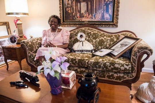 Martha PettIway poses for a picture inside her home in the Madison Park community  in Montgomery, Ala., on Thursday, Nov. 21, 2019.