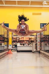 Bella Kash looks really excited for that ice cream in Walmart's freezer section.