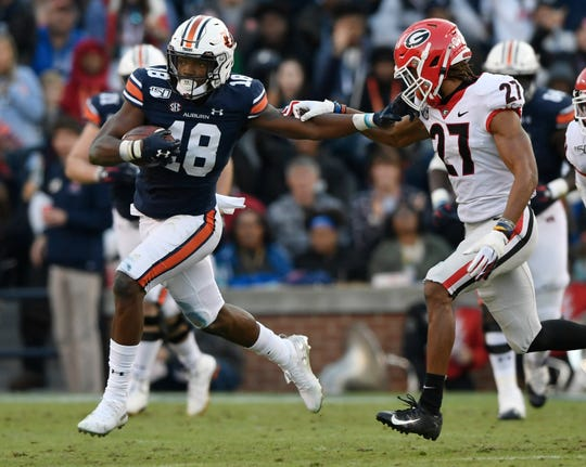 Auburn wide receiver Seth Williams (18) runs after a catch against Georgia on Saturday, Nov. 16, 2019 in Auburn, Ala.