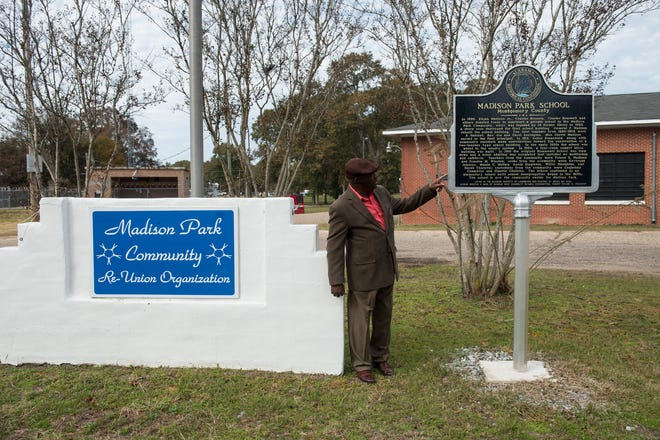 Robert Taylor, board of directors president, poses for a picture outside the Madison Park Community Center in Montgomery, Ala., on Thursday, Nov. 21, 2019.