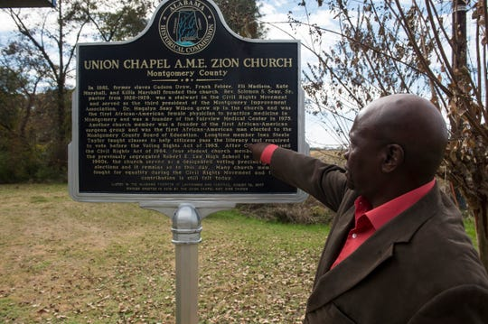 Robert Taylor points out his own mother's name at the Union Chapel A.M.E. Zion Church in the Madison Park community  in Montgomery, Ala., on Thursday, Nov. 21, 2019.
