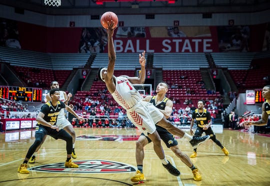 Ball State's KJ Walton shoots past Northern Kentucky's defense during their game at Worthen Arena Wednesday, Nov. 20, 2019.