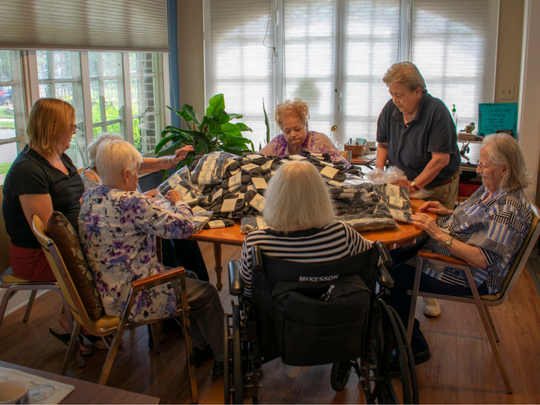 Alpha Center provides adult day services for the elderly. The Community Foundation awarded Alpha Center a $15,000 grant to support operations and programming, like this quilting activity for clients.