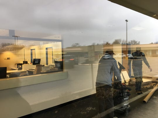 Two workers can be seen on Nov. 21 getting the Riley Health Physicians pediatric clinic ready for business in the Southway Center strip mall.