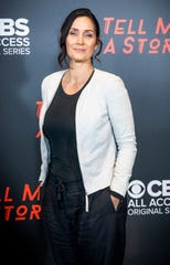 """Carrie-Anne Moss is photographed before the premiere screening for """"Tell Me A Story""""at the Country Music Hall of Fame Wednesday, November 20, 2019."""