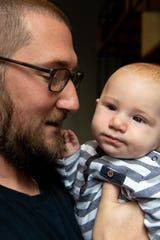 Nick Allen poses for a portrait with his son, August, three months, at the Lyft Office Nashville Thursday, Nov. 21, 2019 in Nashville, Tenn.