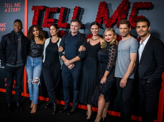 """Members of the cast are photographed with executive producer Kevin Williamson, center, before the premiere screening for """"Tell Me A Story""""at the Country Music Hall of Fame Wednesday, November 20, 2019."""