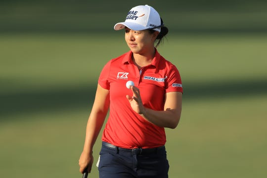 Sei Young Kim of Korea reacts after a putt on the 18th green during the first round of the CME Group Tour Championship at Tiburon Golf Club on Thursday. Kim shot a 7-under 65 and leads by two.