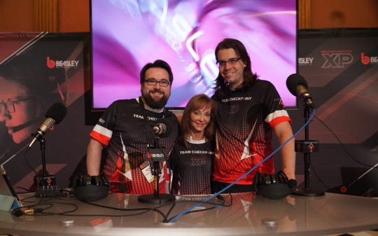 From left to right, Caroline Beasley, CEO of the Beasley Broadcast Group, poses for a photo with Nate Bender and Joe Sloan, co-hosts of the Checkpoint radio show for gamers.