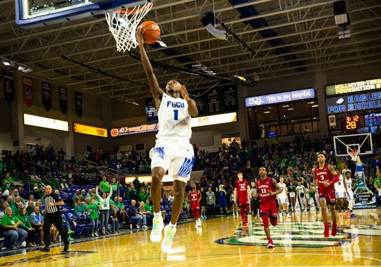 FGCU's Zach Scott hits a layup against Florida Atlantic University on Wednesday, November 20, 2019.