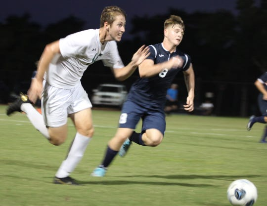 Christian Fischer, left, of Seacrest races for the ball against Marco Island Academy in a game last week. Fischer is a six-year starter and four-year captain for the Stingrays.