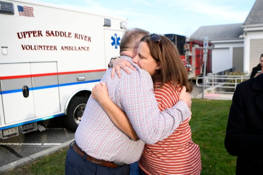 Retiring Upper Saddle River Lieutenant David Lally hugs his wife Katie during his walkout ceremony on Thursday, Nov. 21, 2019.