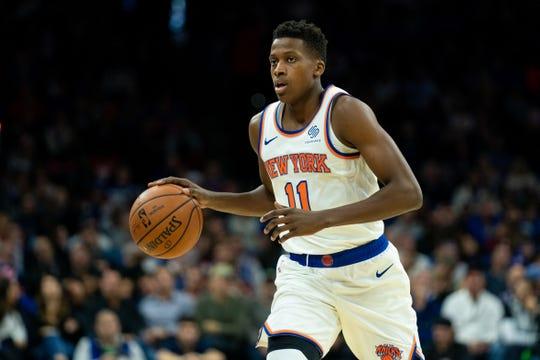 Nov 20, 2019; Philadelphia, PA, USA; New York Knicks guard Frank Ntilikina (11) dribbles against the Philadelphia 76ers during the second quarter at Wells Fargo Center.