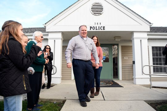 Retiring Lieutenant David Lally and his wife Katie leave the  Upper Saddle River police station during his walkout ceremony on Thursday, Nov. 21, 2019.