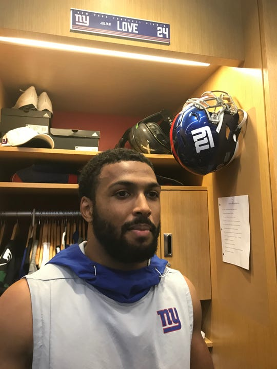 NY Giants rookie Julian Love talks to reporters at his locker following practice in East Rutherford.