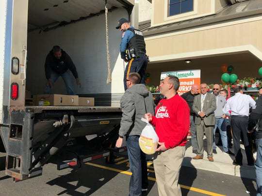 Paramus police officers and Stew Leonard's employees help load trucks with frozen turkeys during the Annual Turkey Brigade on Nov. 21. The turkeys will go to local food banks.