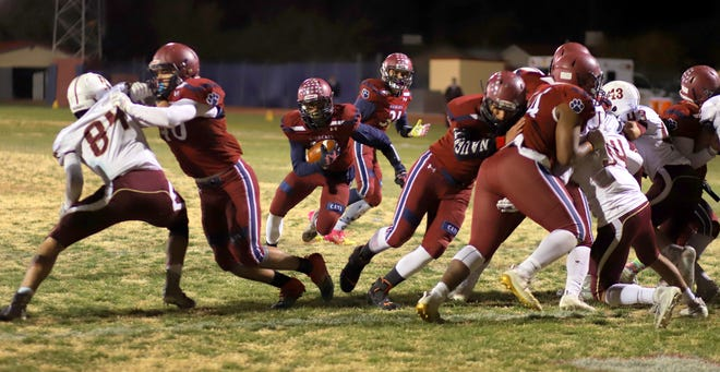 The Deming High offensive line is gashing gaping holes for backs to run though at this point in the football season.