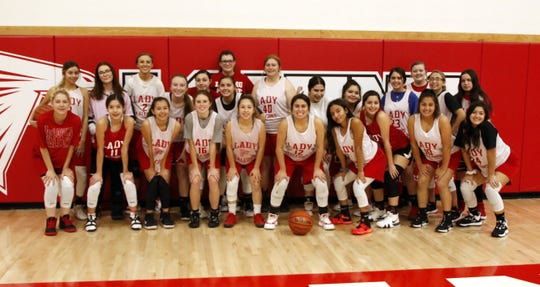 The Loving Lady Falcons varsity and junior varsity squads pose after practice on Nov. 20, 2019. Loving opens its season on the road against Carlsbad JV on Nov. 25.