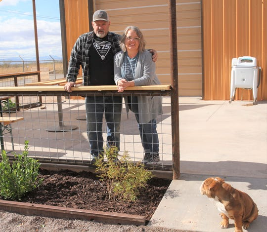 575 Brewing Company co-founders Bill and Vicky Arnold with the the brewery's mascot dog, Barley, on site at the facility on Wednesday, Nov. 20.