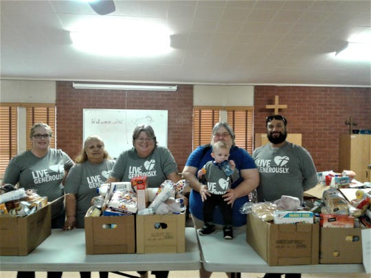 Otero Hunger Coalition volunteers put together Thanksgiving baskets of food for needy area residents. Courtesy photo.
