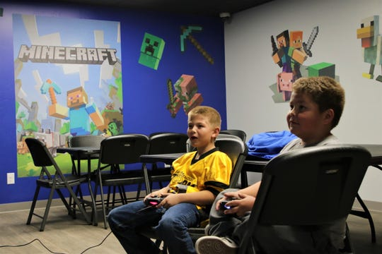 Jordan Mason and Brock Bridges play the latest Mortal Kombat game in one of the private rooms at Nemesis 5 Esports in Farmington on Nov. 20, 2019.
