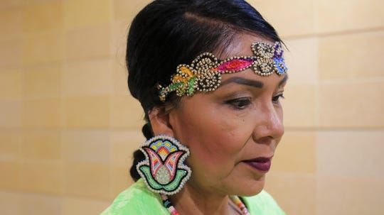 A closeup of Diane Holyan at the Native Skirts Fashion Demo at Northern Navajo Medical Center in Shiprock on Nov. 20, 2019.