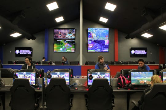 A view of the high-speed gaming computers and the esports competition stage at Nemesis 5 Esports in Farmington on Nov. 20, 2019.