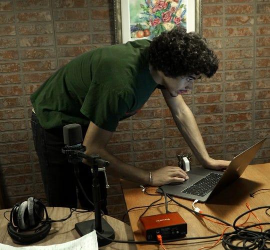 Farmington High senior Max Martin prepares to rap to a song he's working on in his Farmington Hills basement.